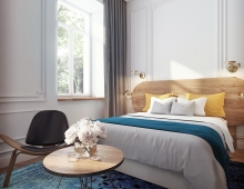 Visualizations of a boutique hotel room 3D model - Hotel room visualization - bedroom area. Fusion style interior in a townhouse: white stucco, wood headboard, industrial gold lamps, wegner shell chair, modern turquoise carpet.